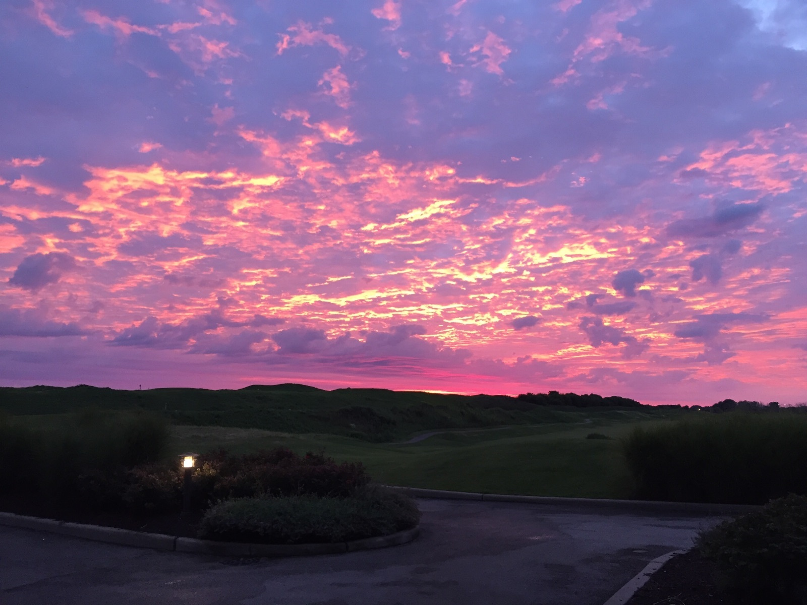 The sun rises on the course at Harborside International Golf Center